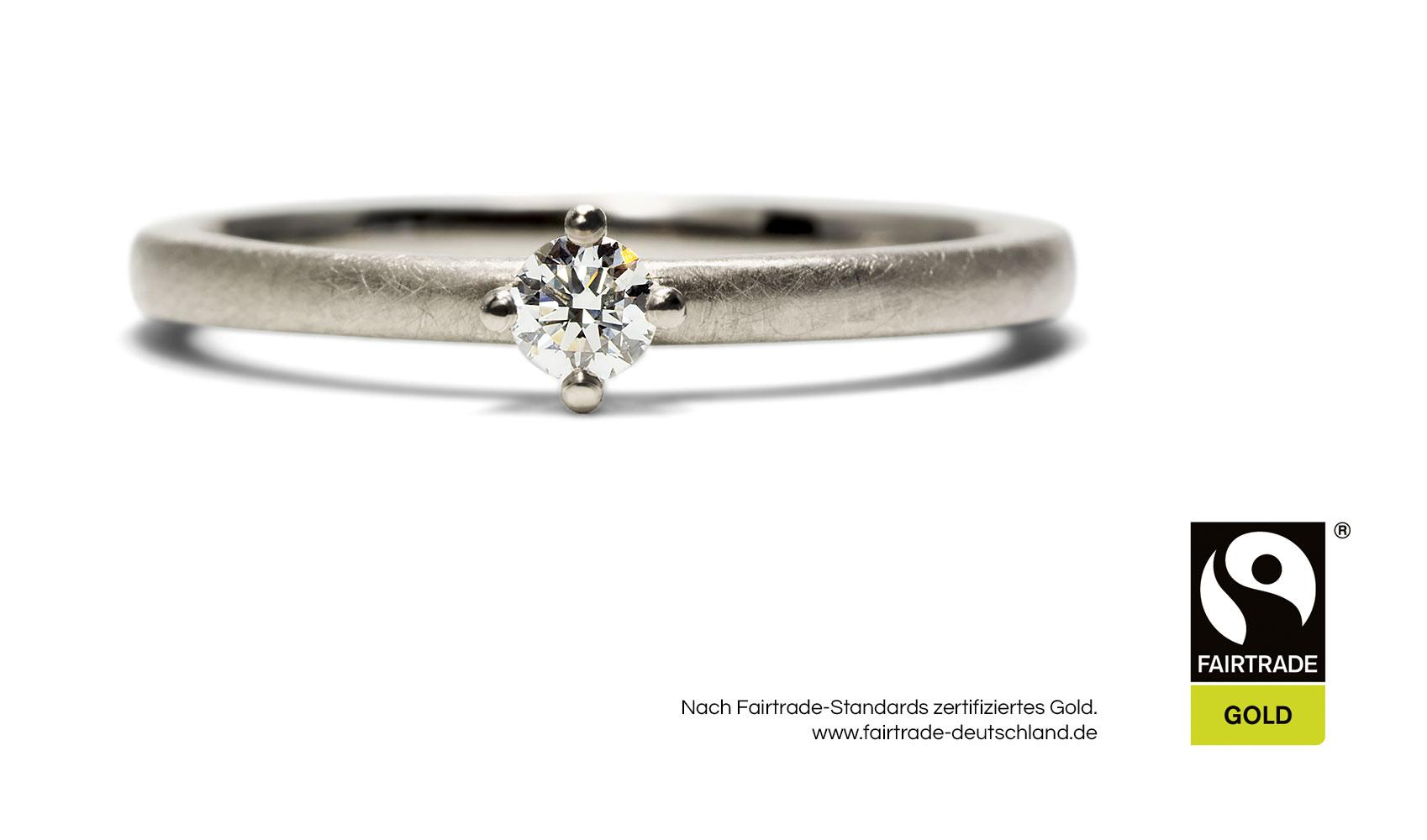 """GOLDAFFAIRS - Verlobungsring """"Enya"""" aus FAIRTRADE Weissgold mit 0,1 kt Diamant"""